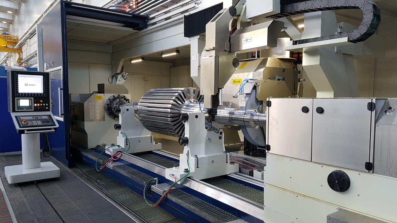 Electric motor shaft grinding