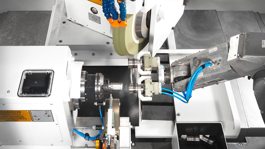 Grinding machine for steering pinions